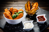 Chicken nuggets with french fries on wooden table - 192750833