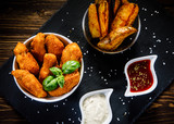 Chicken nuggets with french fries on wooden table - 192750840