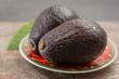 Quadro Fresh dark green organic avocado with leaf