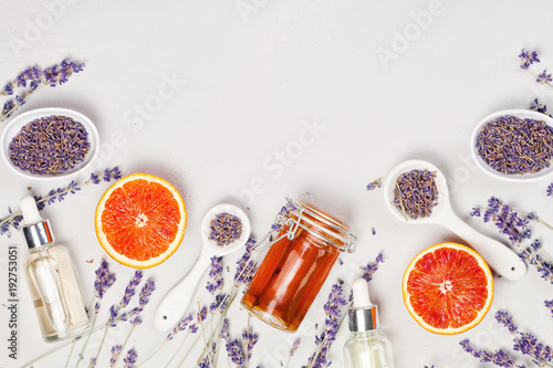 Foto op Plexiglas Spa Orange and lavender body care products. Aromatherapy, spa and natural healthcare concept
