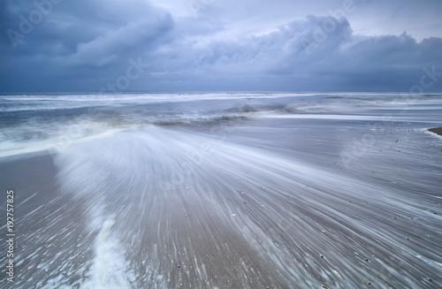Fotobehang Noordzee blurred waves on stormy sea coast