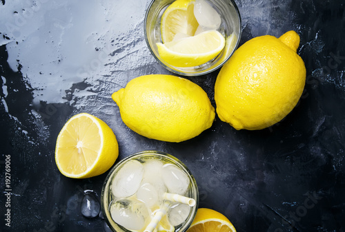 Fototapeta Summer refreshing lemonade with ice and soda, gray background, top view