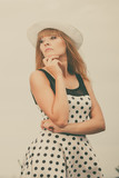 Beautiful retro style girl in polka dotted dress. - 192770258