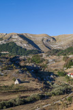 View of a valley with rural houses in the mountains of Montenegro