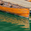 Old Wooden Boat and Green Water