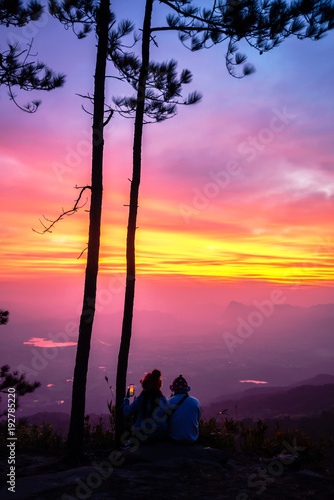 Lover women and men asians travel relax in the holiday. watching Sunrise in the morning. In the winter. In Thailand