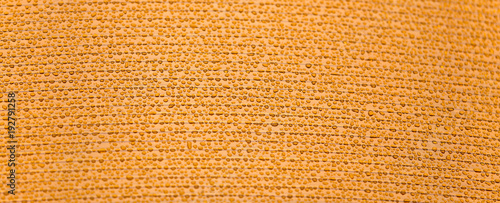 Drops of water on orange plastic as background