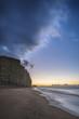 roleta: Beautiful vibrant long exposure sunrise landscape image of West Bay in Dorset England