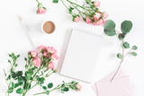 Fototapety Office desk with notebook, rose flowers, eucalyptus branch, pink paper blank. Flat lay, top view, copy space