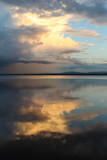 Sunset and clouds reflected in Orsa lake. - 192808451