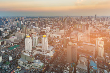 Cityscape business downtown skyline Bangkok Thailand with sunset tone