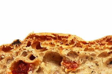 close up of bread crust wth tomato