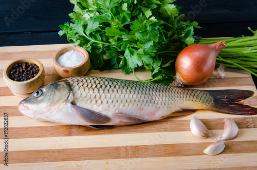 uncooked-fish-on-cutting-board-in-meal-preparation-concept
