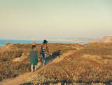 Girs walking ove the coastline - 192825602