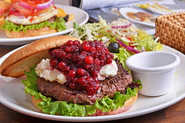 Delicious beef burger with cranberry, salad and ingredients