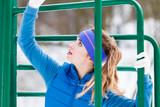 Woman wearing sportswear urban exercising outside during winter - 192828221