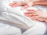 White wrinkles dust mite pillow and bedding cover with woman 's hand. - 192833451