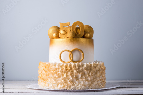 Poster Beautiful cake for the 50th anniversary of the wedding decorated with gold balls and rings