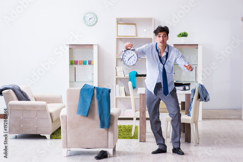 Wall mural Businessman late for office due to oversleeping after overnight working
