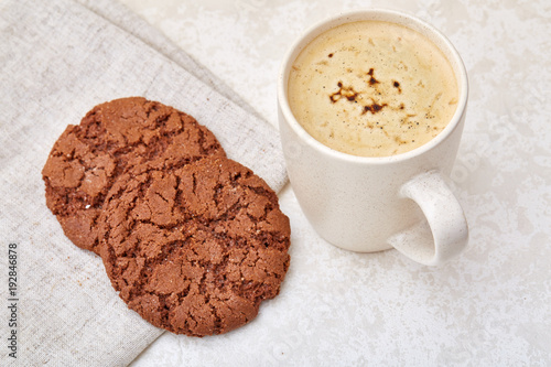 Sticker Cup of coffee and biscuit isolated on the white background, close-up, shallow depth of field.