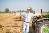 Smiling farmer in his field - 192847475