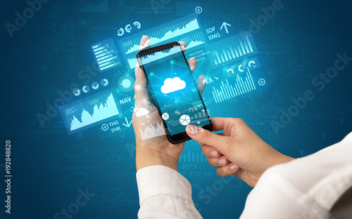 Hand using phone with financial tracking concept - 192848820