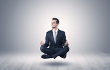 Businessman meditates in an empty space concept - 192850224