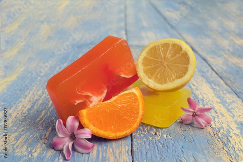 Foto op Plexiglas Spa Handmade natural soap with and natural ingredients: lemons and oranges, on rustic wooden board. Spa concept