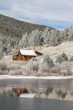Cabin reflected in frozen pond.