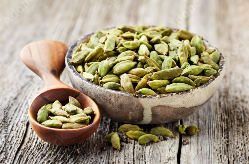 Cardamom on wooden background © Dionisvera