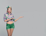woman, dressed in pin-up style, showing something or copyspace - 192860446