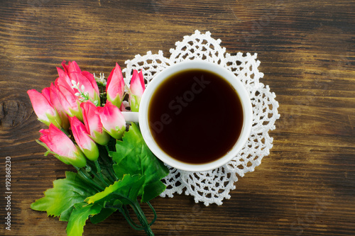 cup-of-tea-and-pink-tulips-on-a-wooden-background-a-bouquet-of-pink-tulips-and-a-cup-of-coffee
