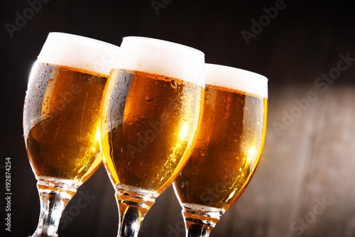 Fototapeta Composition with three glasses of lager beer