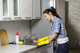 Young woman washing dishes in the kitchen - 192880482