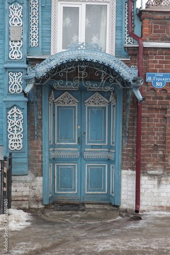 Wooden door with carvings on country houses in Russia