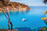 Picturesque scenery of coastline of Turkey on Mediterranean sea. Solitary luxury white yacht in the incredible bay. Summer vacation background. Location Antalya Turkey. - 192890473