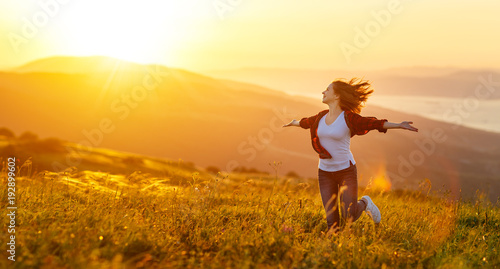 Poster Happy woman   on sunset in nature iwith open hands