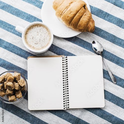 Fotobehang Koffiebonen Cappuccino on a striped tablecloth. Morning coffee.