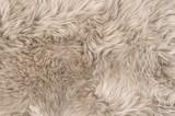 Natural sheepskin rug background texture sheep fur