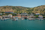 Resort town. Boat parking and modern buildings on the Black Sea coast of the Balaklava bay, Crimea, Russia - 192902282