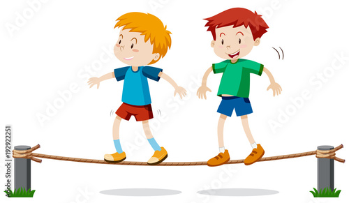 Two boys on balancing rope