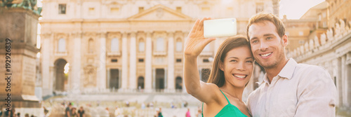 Rome tourists on honeymoon vacation taking selfie photo with phone in front of Vatican, banner panorama horizontal crop. Couple in love on summer holiday, europe travel.
