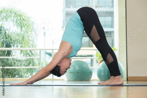 Plakat yoga class studio,asian woman master doing dolphin pose,Healthly lifestyle sport