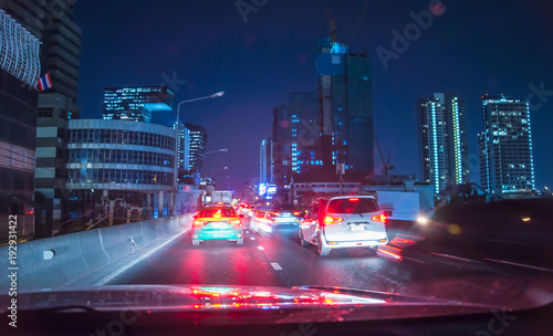 Traffic light at night in Bangkok, Blurred background - 192931422