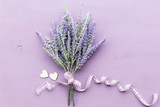 Lavender flower on purple wooden background. - 192938260