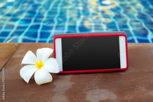 Smartphone with black screen near pool. Vacation concept - 192939633