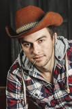 Portrait of a Cowboy. dark hair, jeans , plaid shirt. - 192942898
