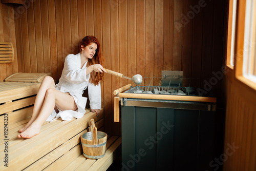 Beautiful woman relaxing in finnish sauna - 192943233