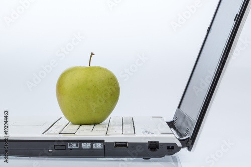 Staande foto Vruchten apple lies on a keyboard