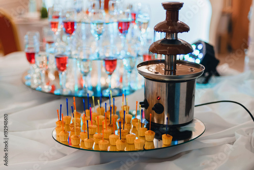 chocolate fountain for fondue with sweet canape for dessert at the event